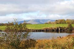 Ireland_House_Mountain_and_Lake.jpg